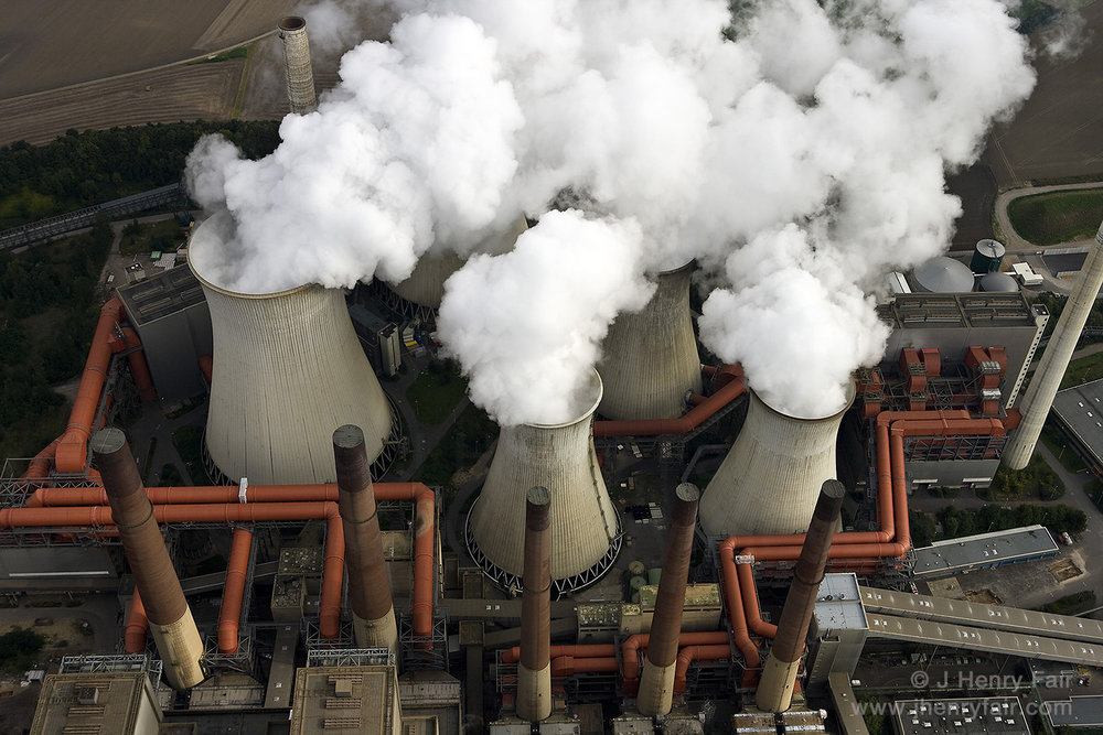 Smoke And Mirrors. Steam Rises From Cooling Towers At Coal Power Plant