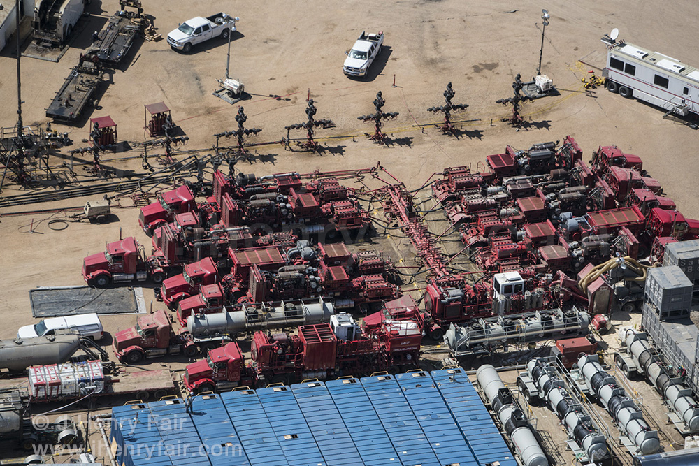 Compressor trucks, well-heads and chemical tanks at fracking site, Boulder, CO