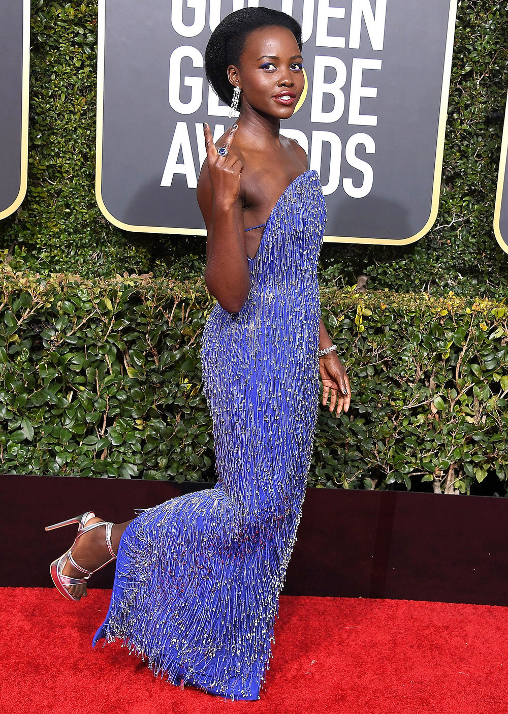 Lupita Nyong'o - gives us updated Gatsby vibes on the red carpet in electric Calvin Klein, chandelier earrings and a matching cuff, all while proving the higher the heel doesn't have to equal higher the price…