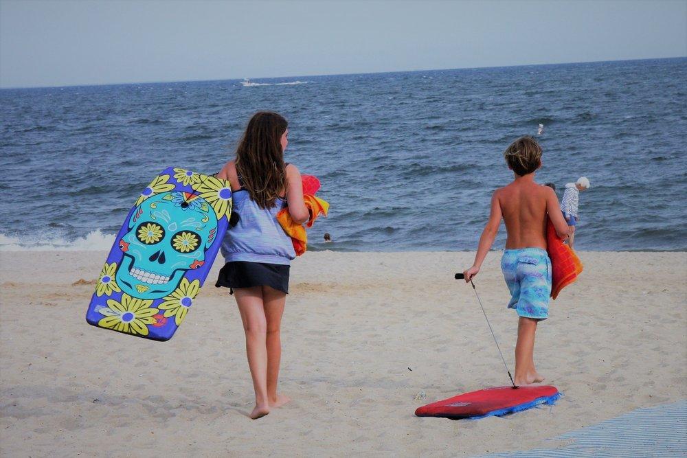 fun in the sun with boogies boards.JPG