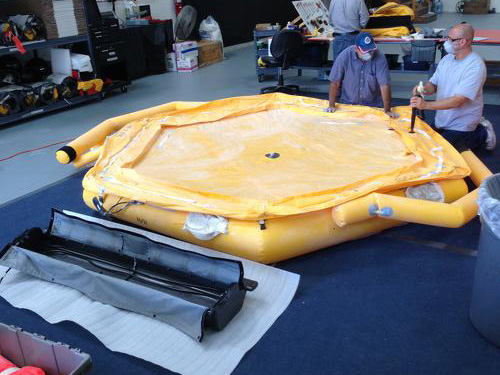 Emergency Life Raft being prepared for packing.