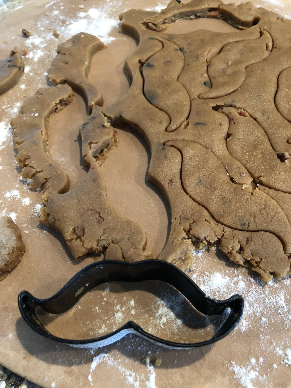 Muttstache Cookies - $12/18 CookiesWhat dog doesn't love a peanut butter and bacon combo?! We promise your dog will beg for these crumb catchers.