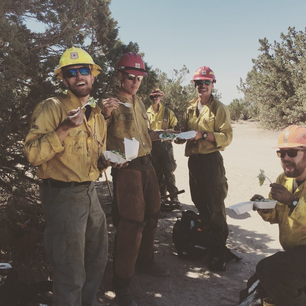 Crew members taking a quick break to eat a tasty salad before the desert heat wilted it on a fire in Utah in 2017.