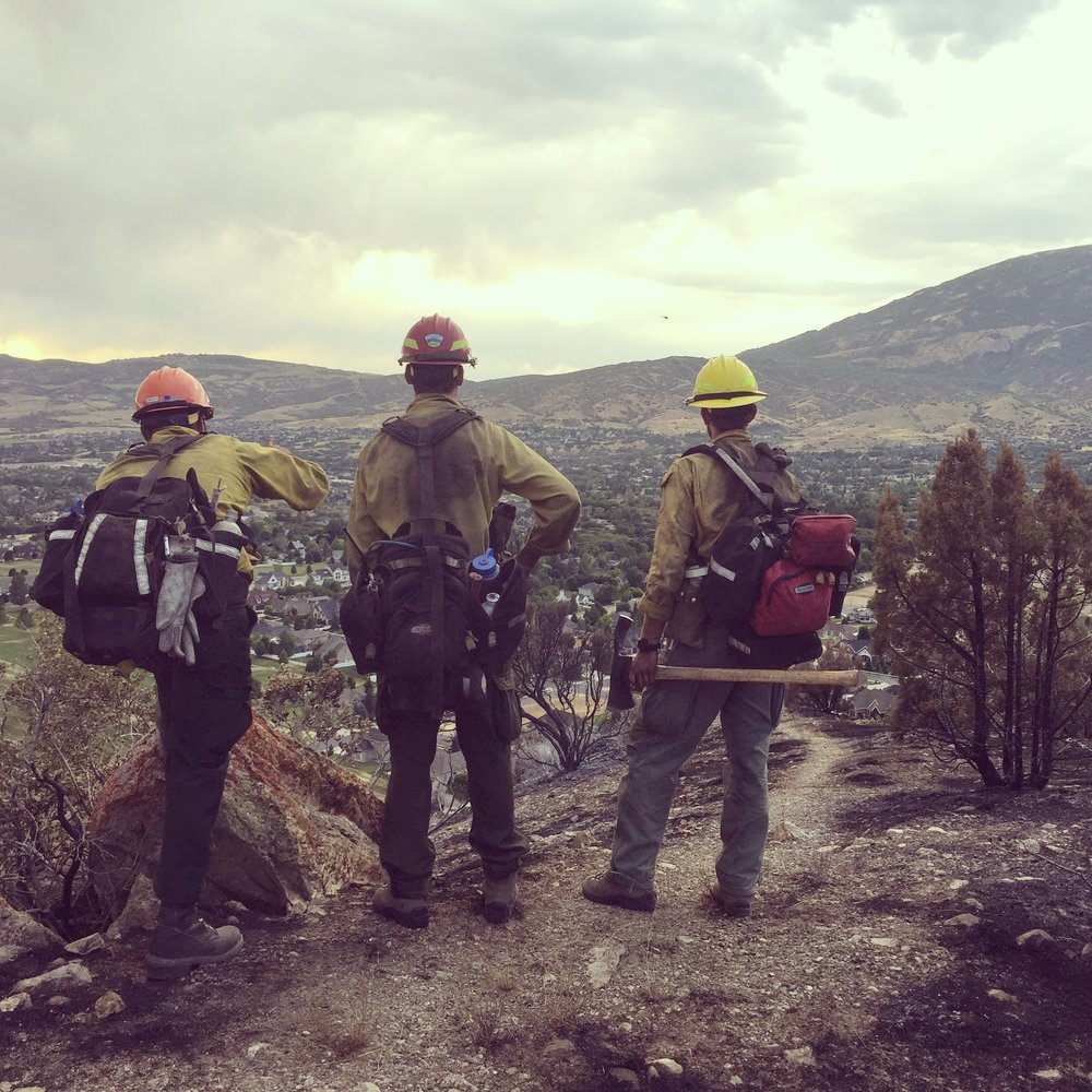 Firefighters pausing to assess a storm coming towards them on a fire in Utah 2017. Note how everyone's pack is a just a little different depending on their preferences.