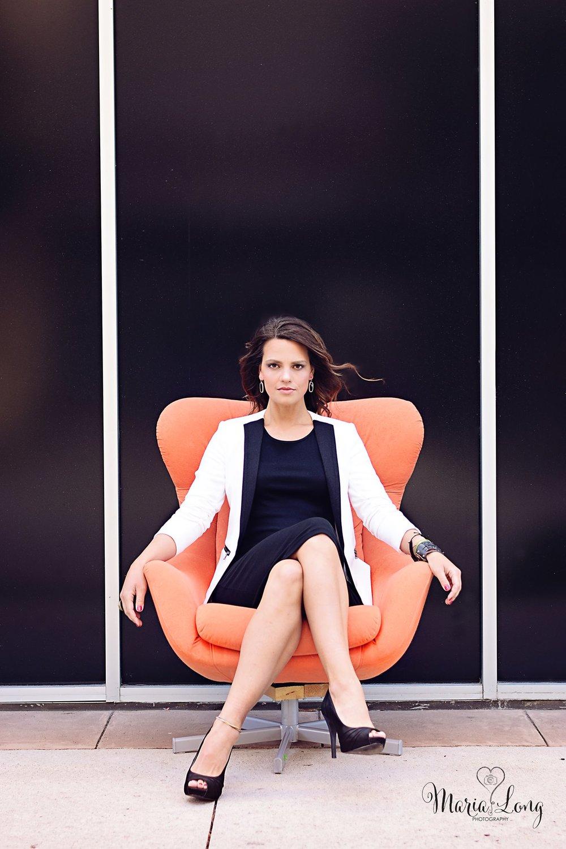 headshot orange chair.jpg