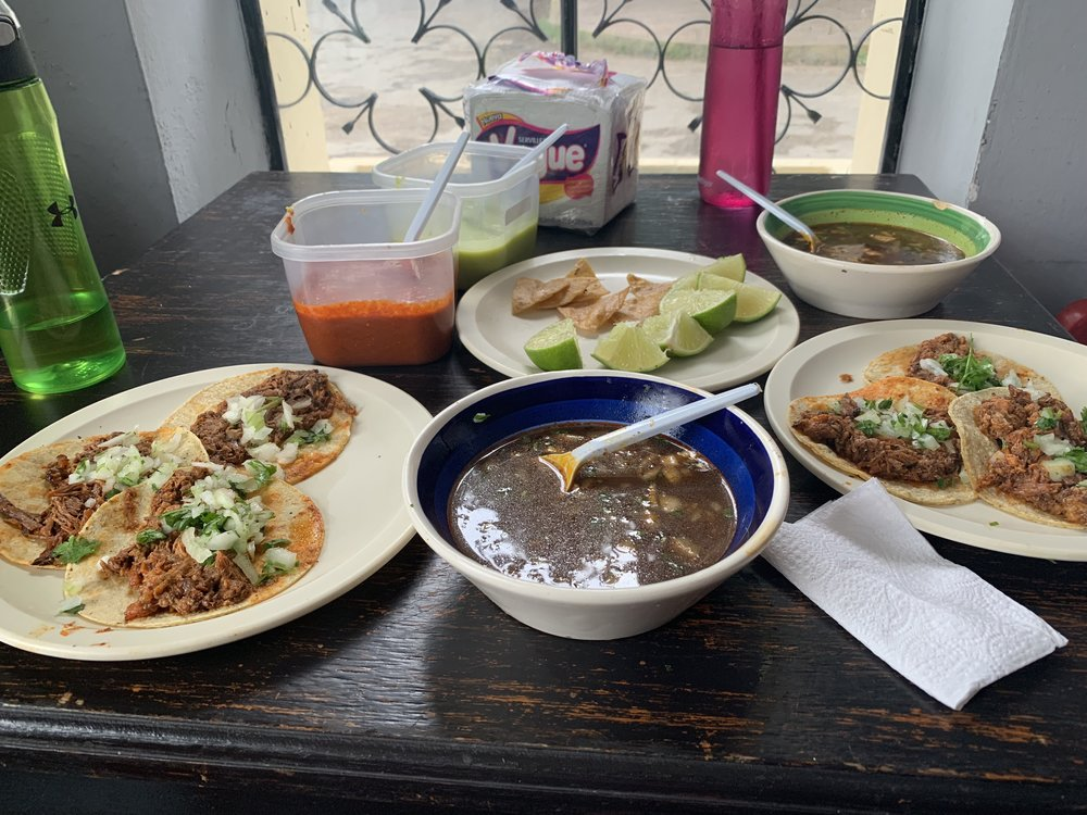 Barbacoa tacos and consomme in Valladolid.