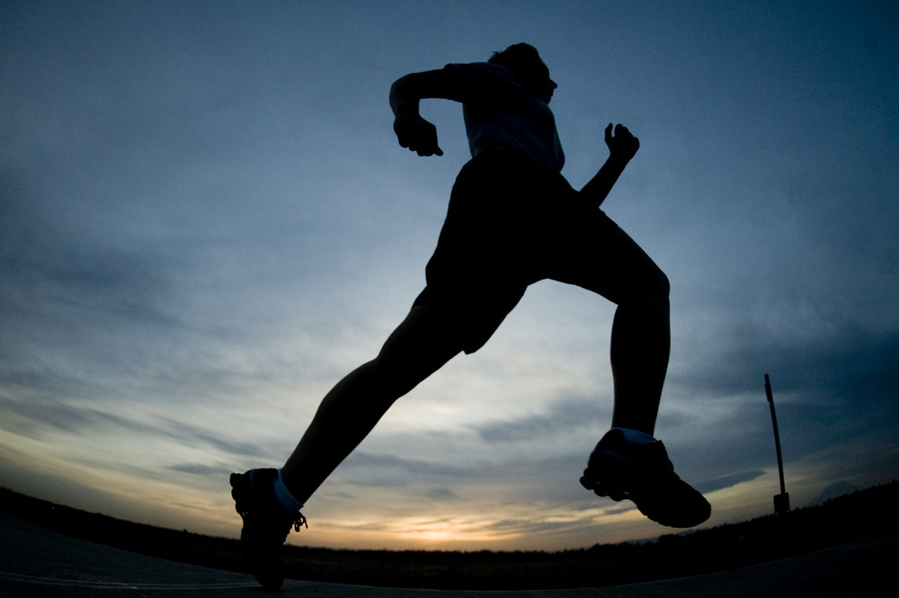 Man running at twilight. Managing performance anxiety fears and being successful.