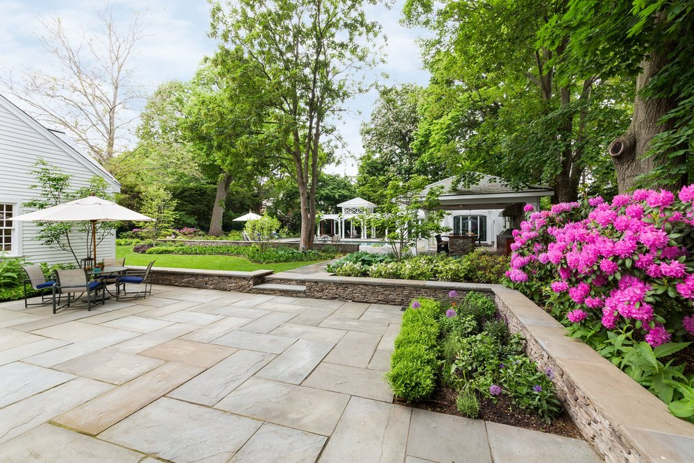 Landscape design with bluestone patio in Belmont MA
