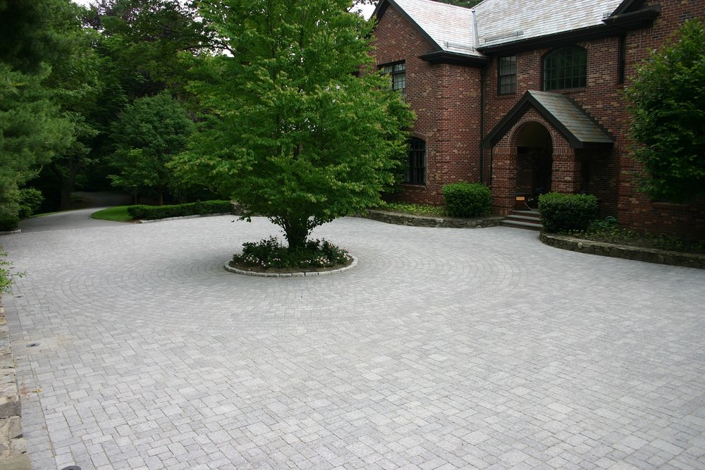 Landscape design in Lincoln MA with paver driveway