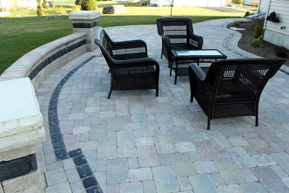 Bluestone patio with retaining wall in Belmont, MA