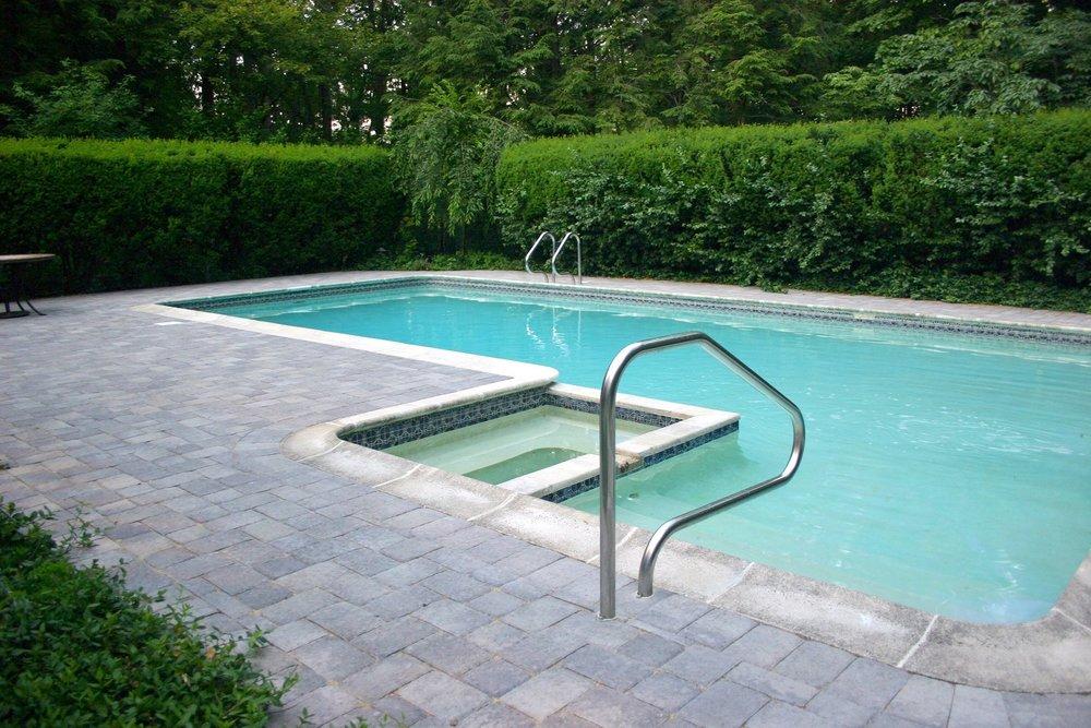 Unilock patio pavers for pool deck in Lexington, MA