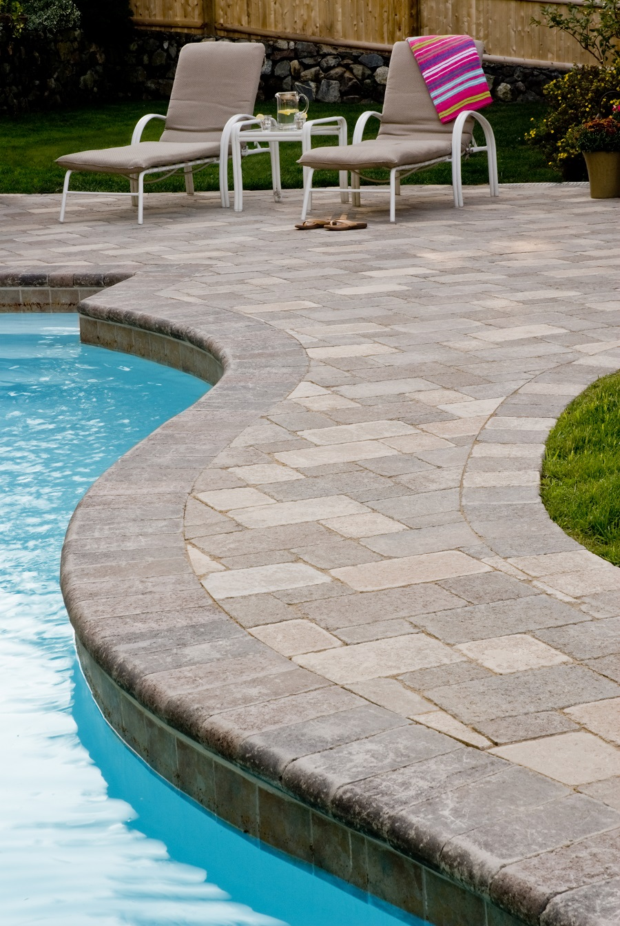 Pool deck with durable patio pavers in Arlington, MA