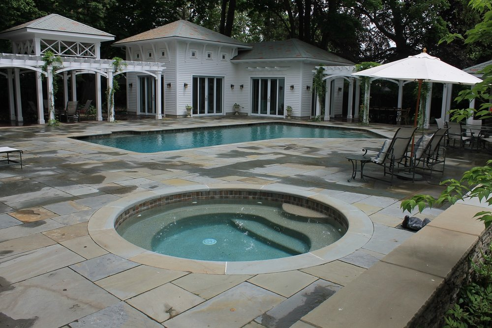Landscape design with pool deck in Newton, MA