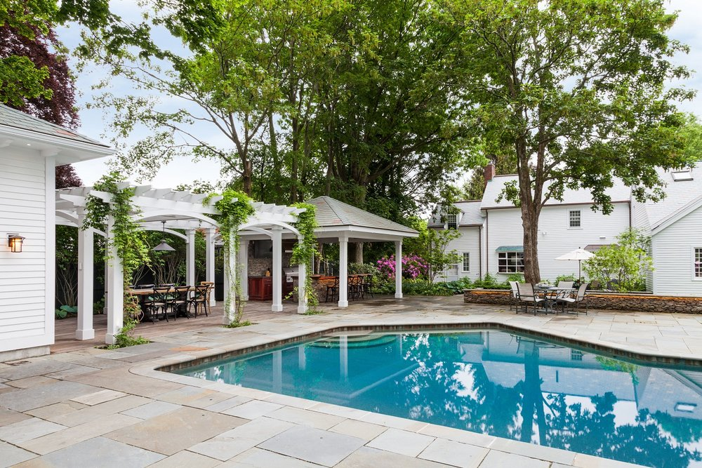 Landscape design with pool deck in Wellesley, MA