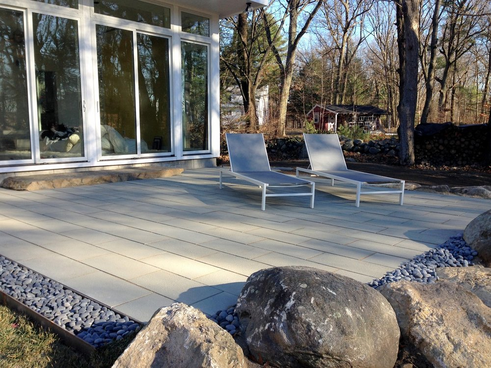 Landscape design with stunning bluestone patio in Wellesley, MA