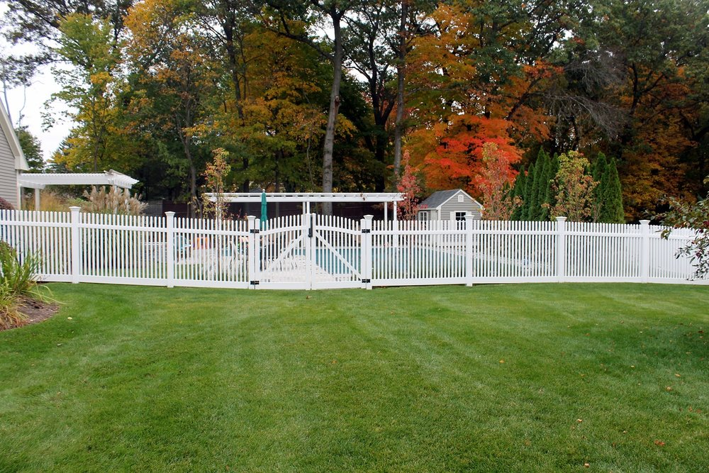 Landscape design with fencing in Lincoln MA
