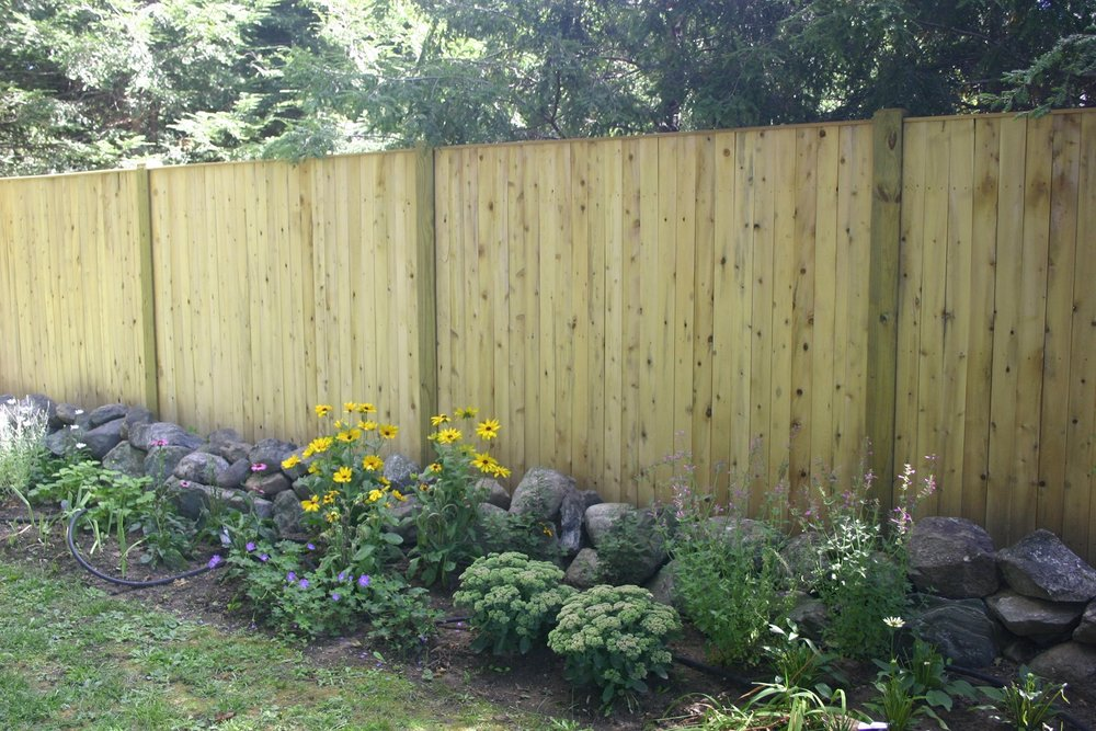 Landscape design with fence in Belmont, MA
