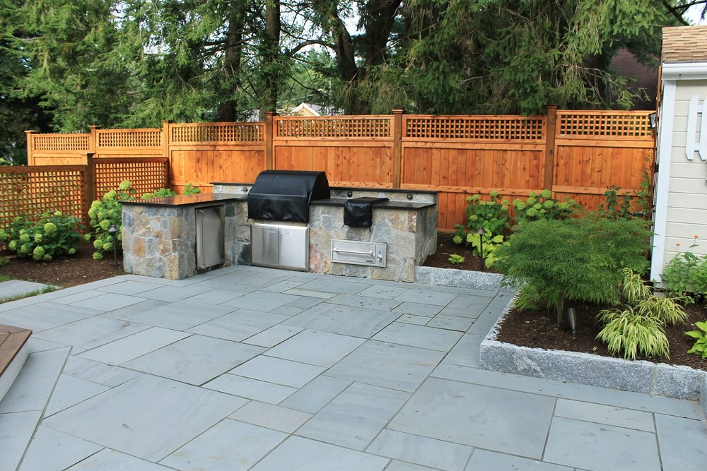 Bluestone patio with outdoor kitchen in Arlington, MA