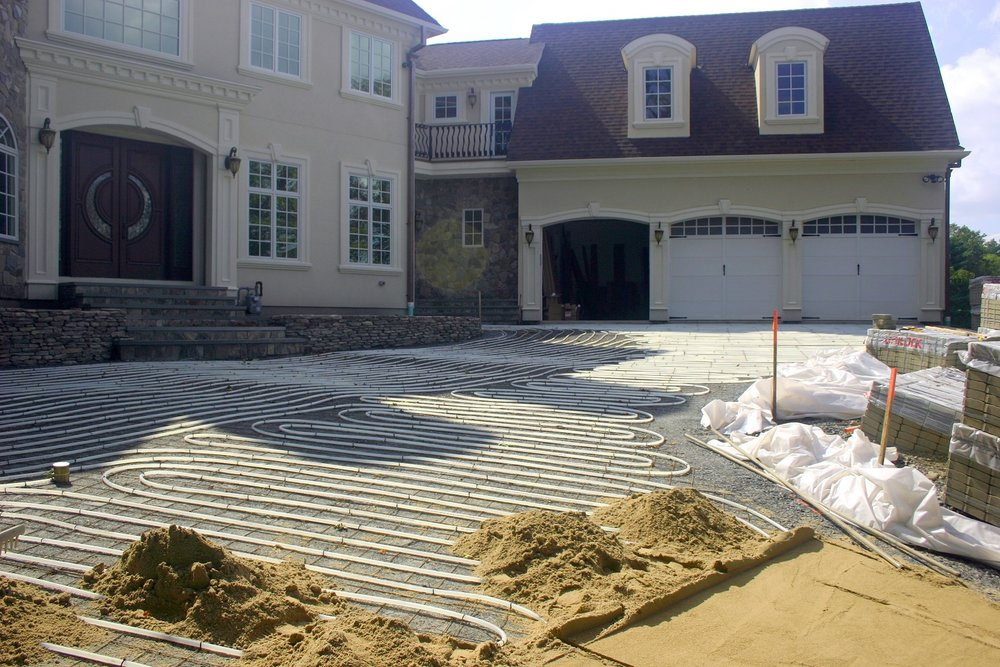 Installation of snowmelt system with permable pavers in Belmont, MA.