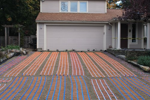 Installation of a snowmelt system with permeable pavers in Wellesley, MA