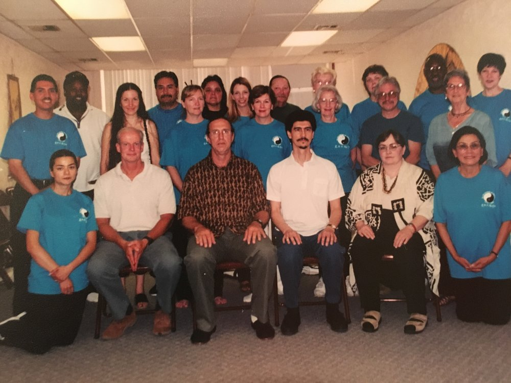 Gathering in 2000  Charles Ettner is seated in the middle in the print shirt with Richard Parker next to him on the right, followed by Chris Marie Brown. John Simpson teaches morning classes and is standing in the back row on the right.