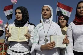 Women-holding-Bible-and-Quran.png