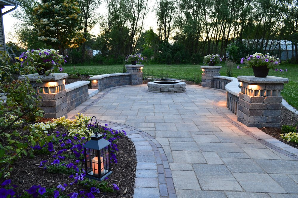 Copy of Copy of Outdoor fireplace with stunning landscape lighting in central Illinois
