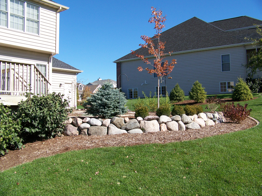Landscape design with retaining wall in East Peoria, IL