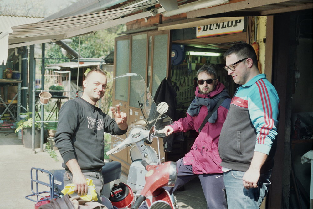 Fede with mechanic and Vespa expert Alessandro (left) & Joe