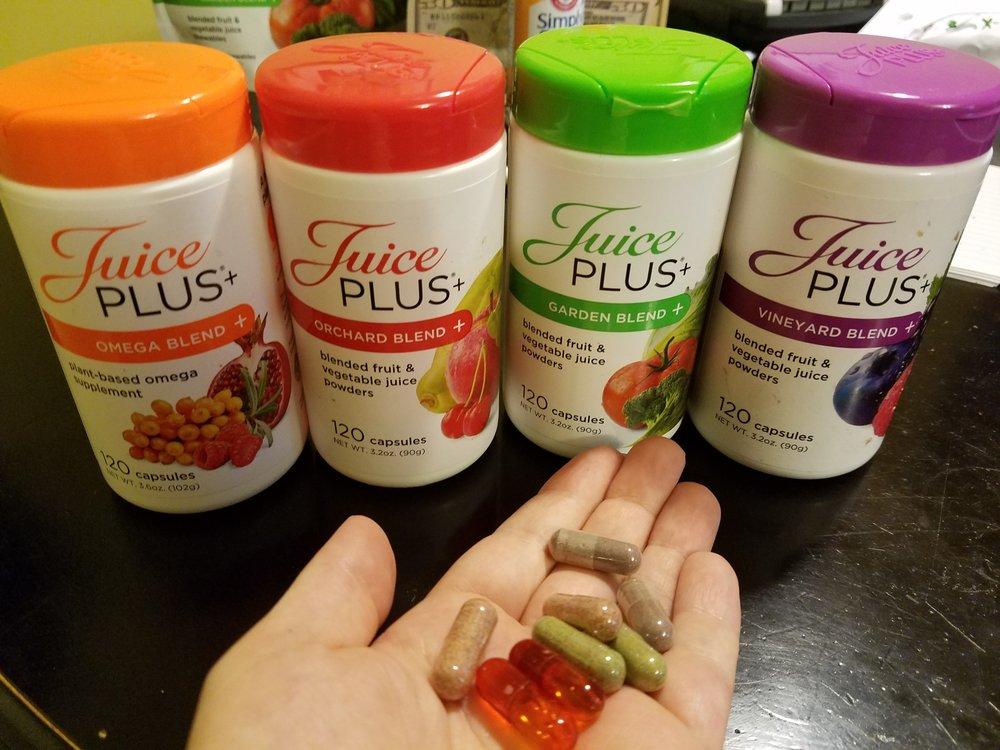 capsules in hand.jpg