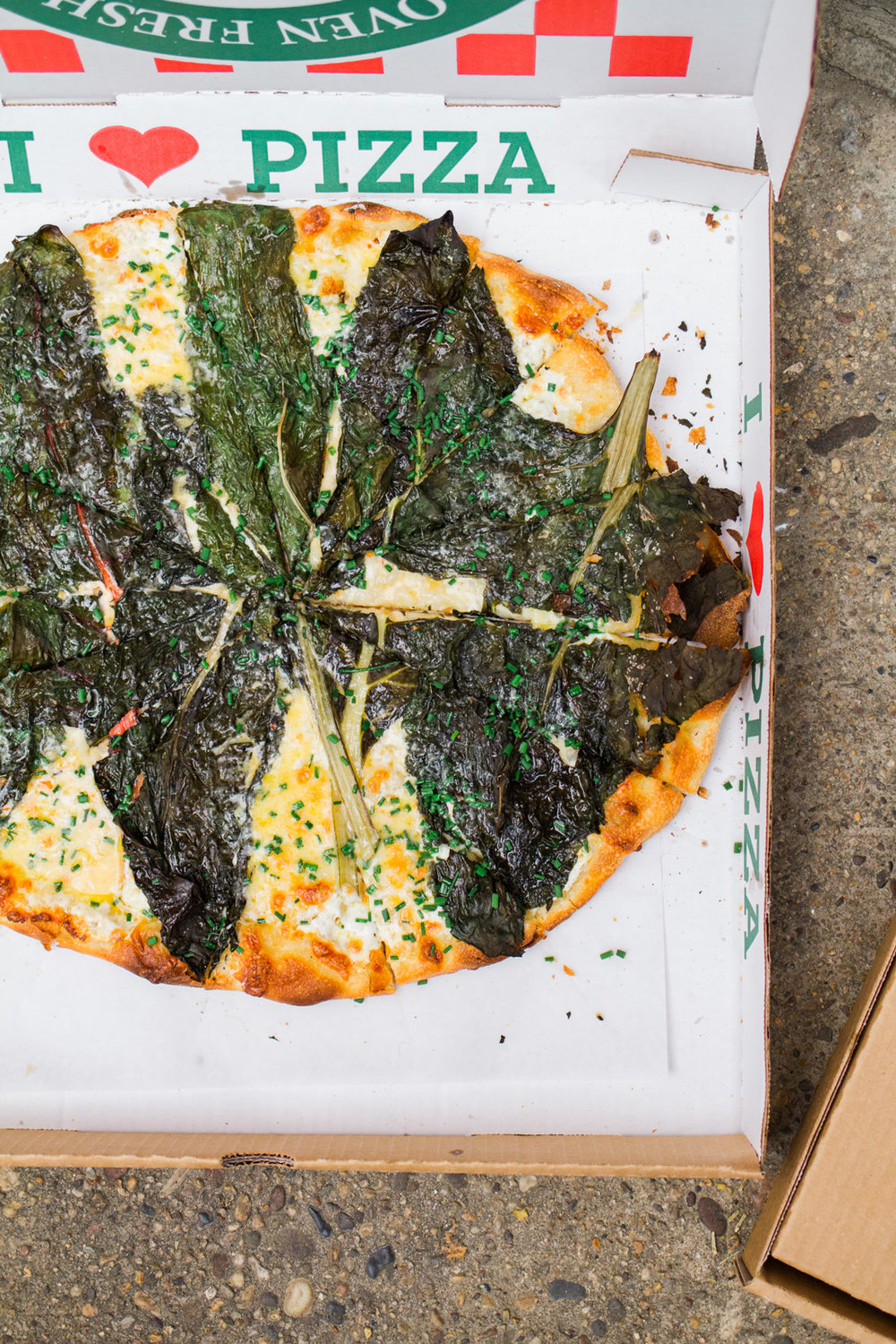 The famous pizza from Pizzeria Beddia in Philly with swiss chard all over it