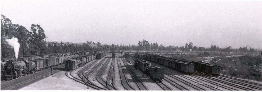 Taylor Yard, near the original northern city boundary. The receiving tracks at the north end of the facility are visible, with the main line tracks at far left and the Los Angeles River at right. —John Signor Collection
