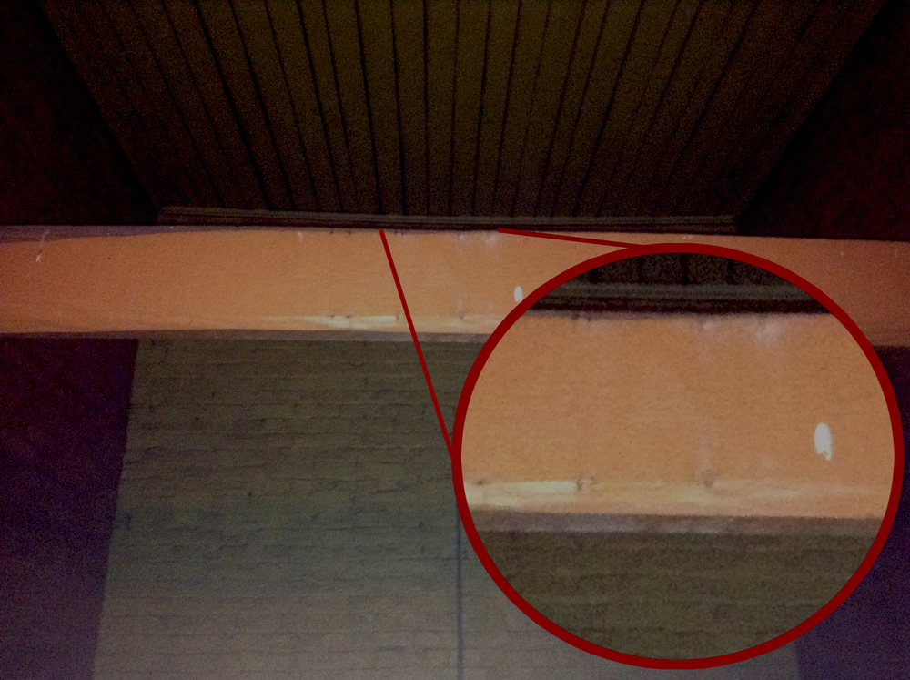 The beam in the gallows stairwell.