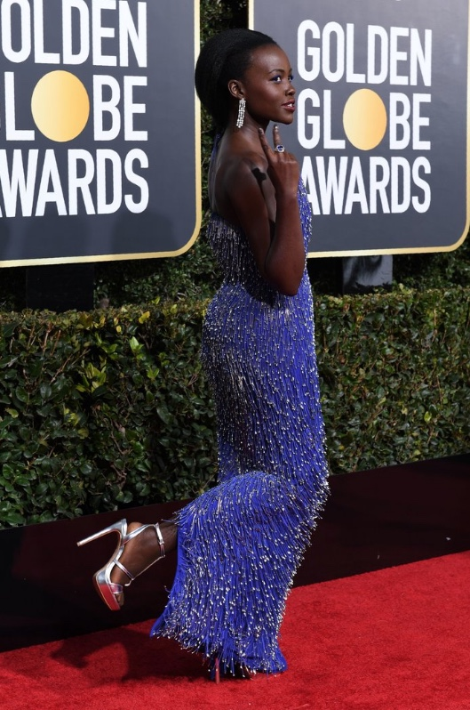 Lupita Nyong'o wearing Calvin Klein by Appointment and Bulgari jewelry