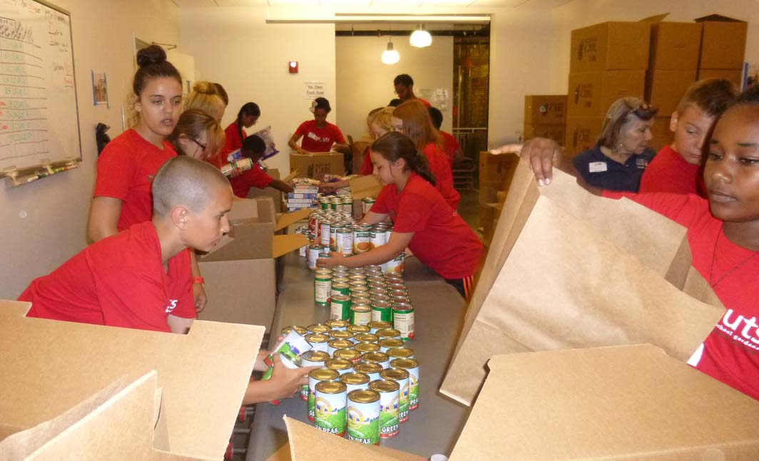 CitySprouts interns sort canned food at the Greater Boston Food Bank