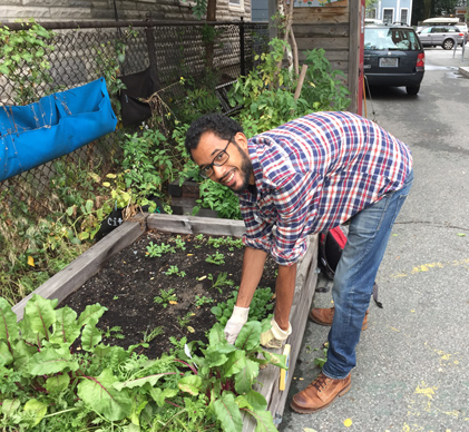 Solomon getting the garden ready for the school year