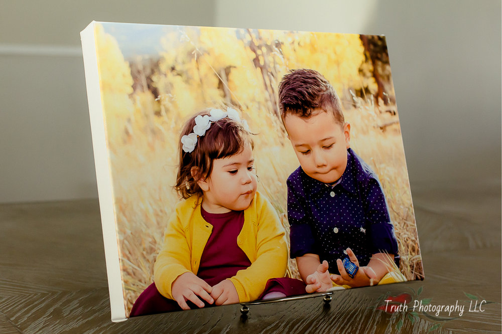 #1 Canvas Prints - I love a canvas print for mom for those images that she will want to hang forever. Newborn portraits or that family image that came out so perfectly are the types of images I recommend for this. These are images that you aren't going to want to replace. Canvas is also perfect because she won't have to go find a frame to hang it. NEVER give mom a gift that will require more work!