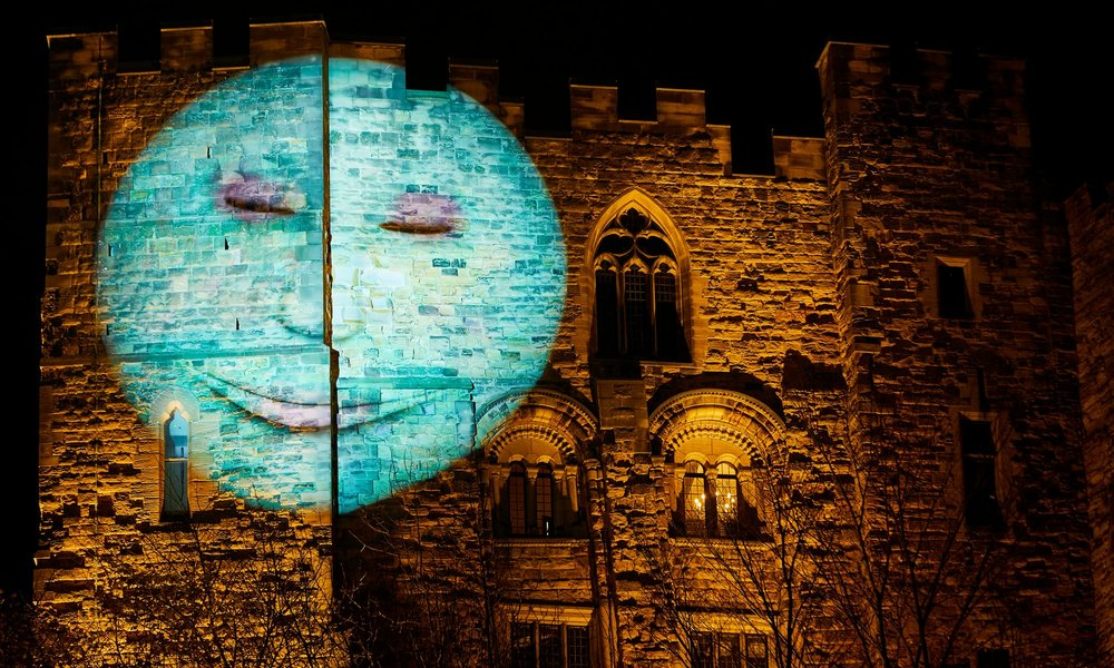 Our Moon, by the British artist Hannah Fox, projected on to Durham Castle. It looks, blinks, smiles, twitches and frowns. Each evening a different moon – representing childhood, youth, maturity and wisdom – will observe the city and its residents Photo:   The Guardian