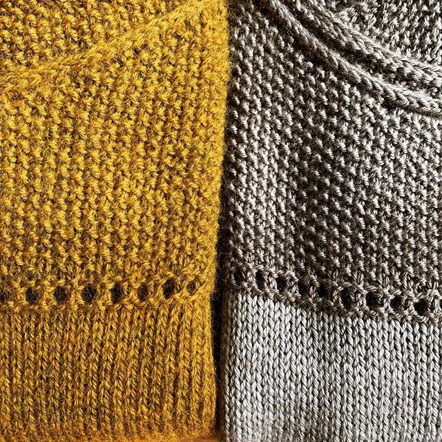 I've been knitting up my new cropped sweater pattern (soon to be released) in a few lovely yarns to try it out... the golden one is @jarbontextiles #devoniadk and the grey one is @edencottageyarns #milburndk in Rain and Steel.  Both yarns are a dream to knit with. The Milburn Dk has the most beautiful silky drape once blocked.  Love these yarns ❤️ #indieknitdesign #knitting #indiedyers #knittersofinstagram