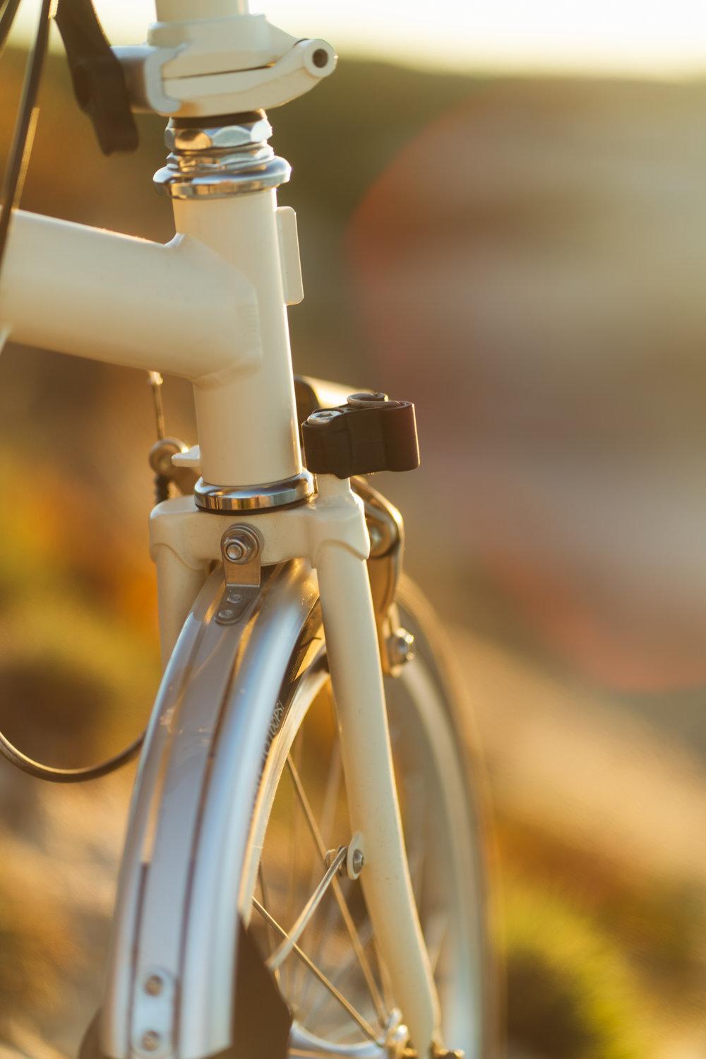 Brompton bike detail with sunset light.