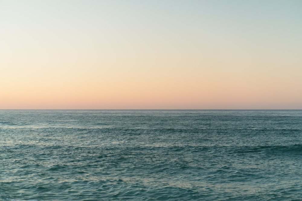 Ocean at sunset with the horizon line.