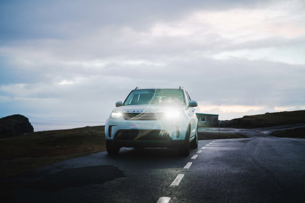 Land Rover Discovery in Scotland with light reflection.