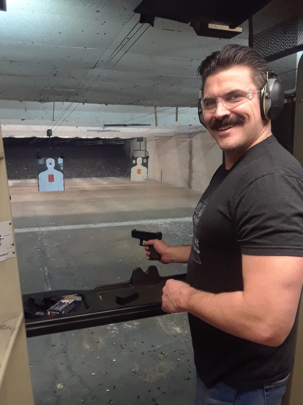 """Tyler Allen - Tyler is a Naval Special Warfare Combat Crewman veteran who served overseas in Iraq, Colombia, and many other countries. He is currently a deputy for the LA County Sheriff's Department and also an NRA certified instructor in handgun. If there is one skill Tyler will have you remember after your class and well beyond is to """"KEEP YOUR FINGER OFF THE TRIGGER"""" until ready to shoot. Tyler brings not only his firearms expertise to the range, but also his calm, composed demeanor which allows new shooters to feel relaxed and confident."""