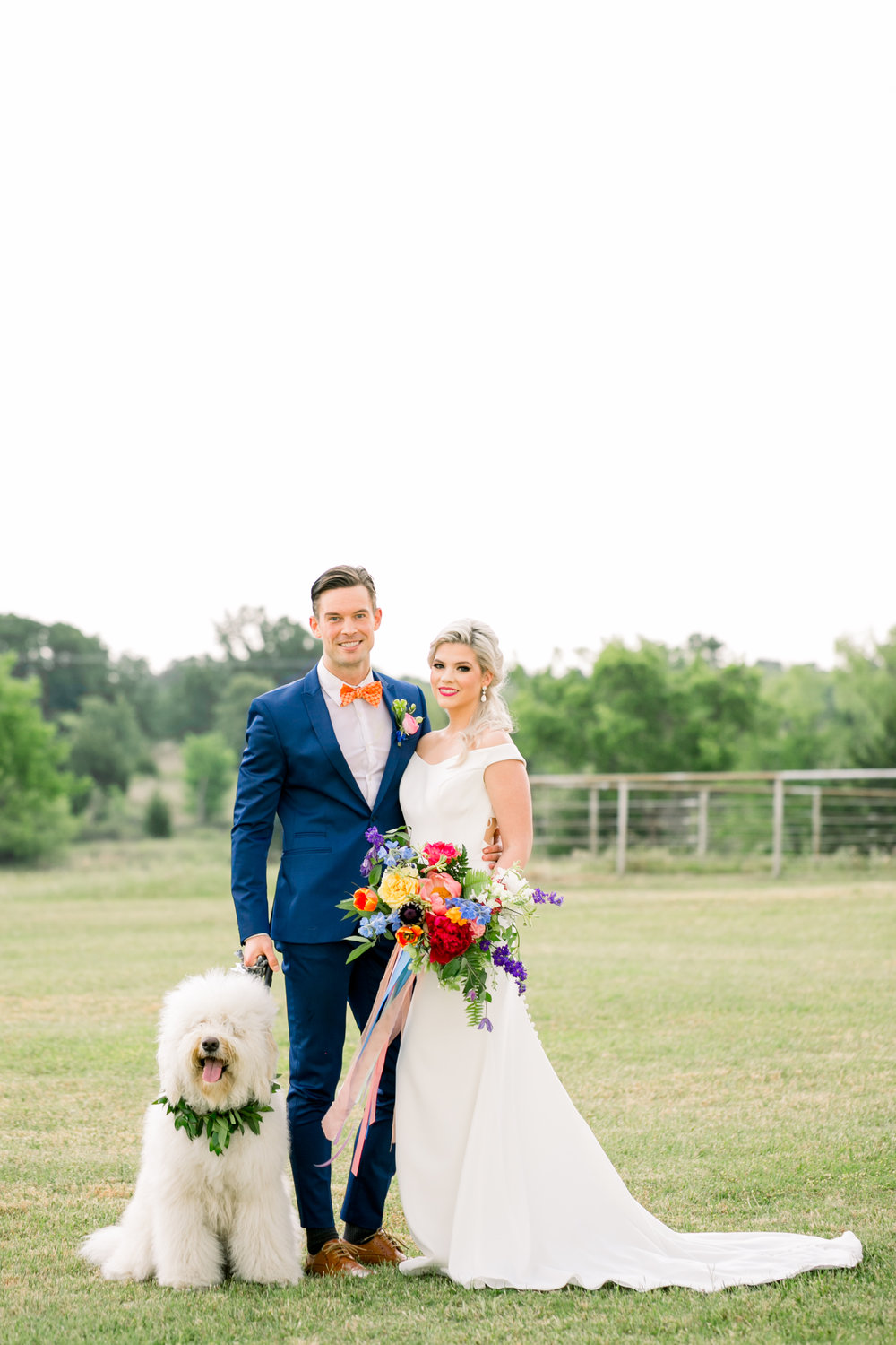 Colorful Wedding Portrait of Bride and Groom with Flower Dog