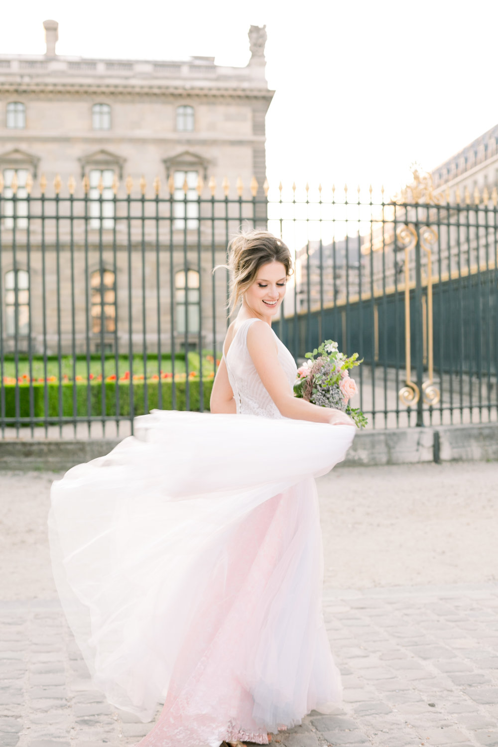 PARIS BRIDAL PORTRAIT BY THE LOUVRE IN PARIS FRANCE BY ABBIE MAE PHOTOGRAPHY
