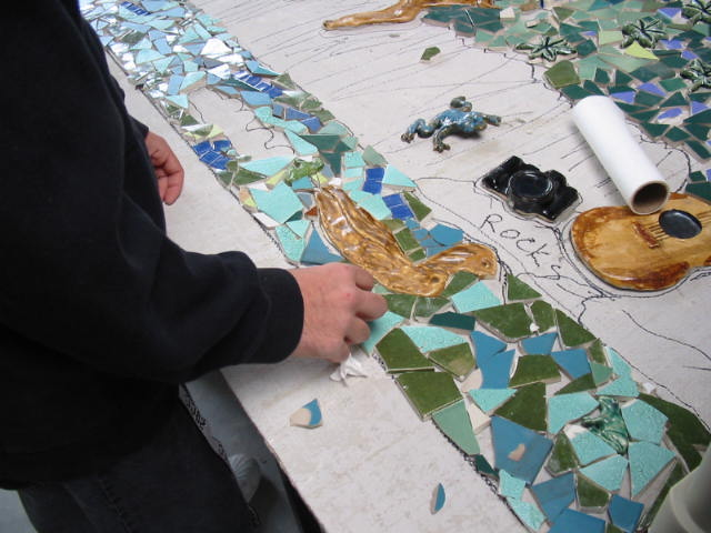 students gluing mosaic pieces