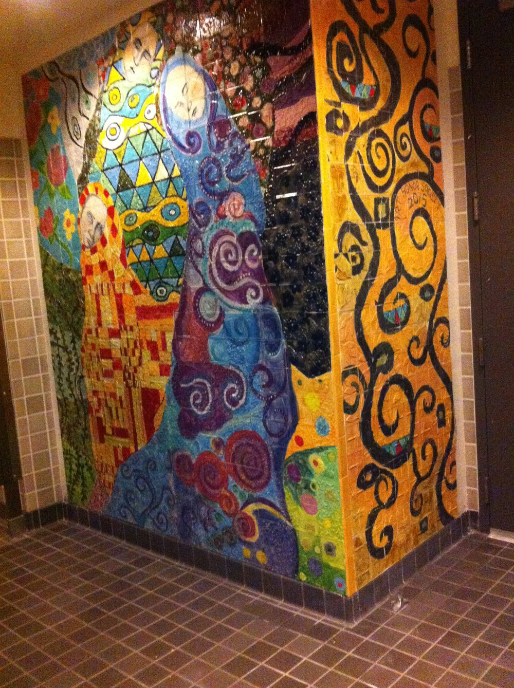 Klimpt inspired painted tile mural in girls bathroom in the Art Building