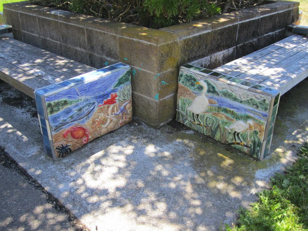 end cap bas relief tiles on benches