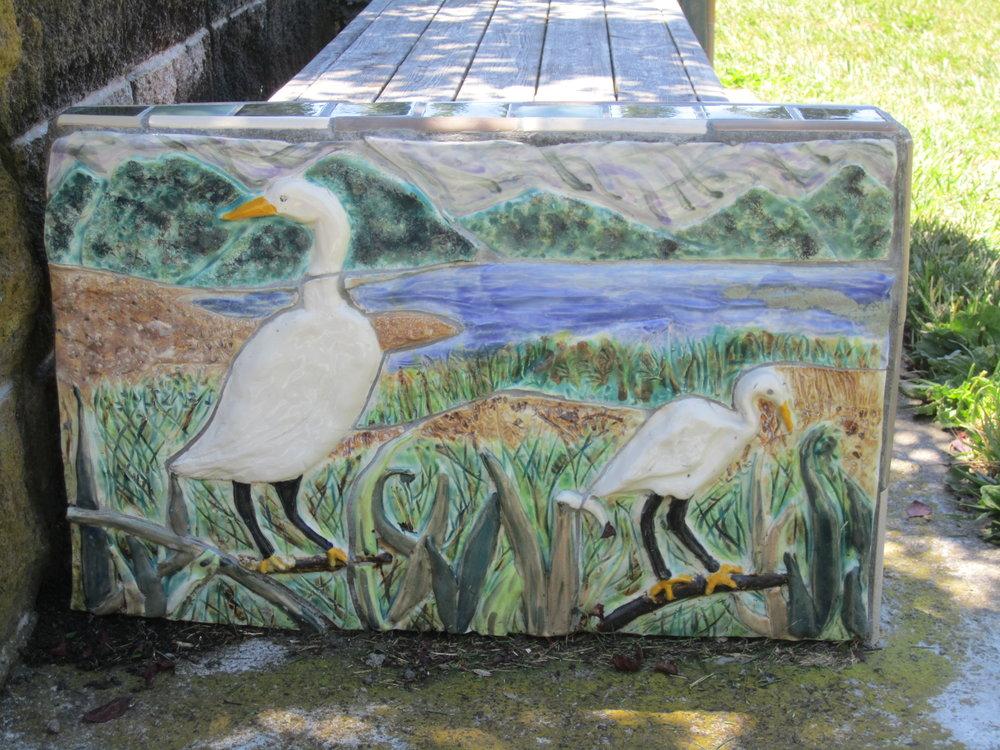 bench end cap of birds