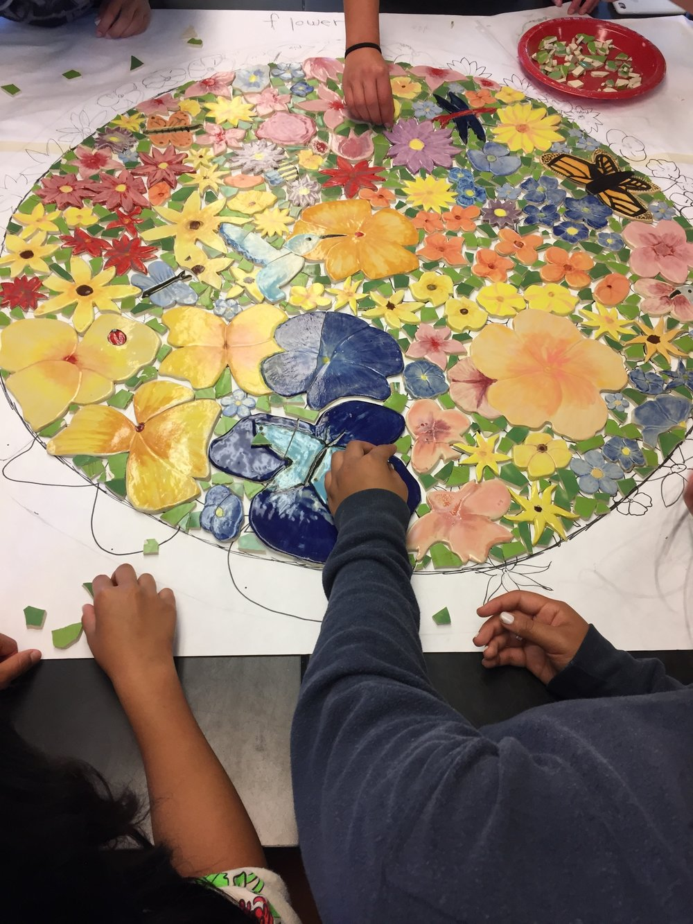 students making tile table top